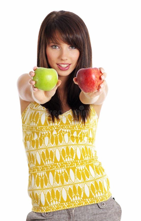 härlig flickaholding för äpple arkivfoton