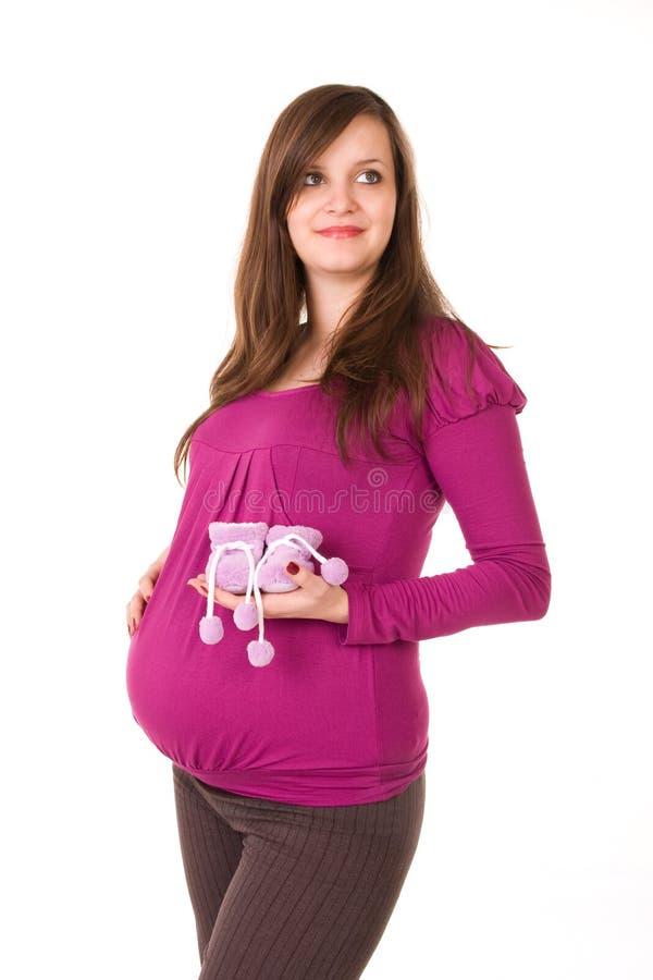 Härlig gravid kvinna - som isoleras över en vitbakgrund royaltyfria bilder