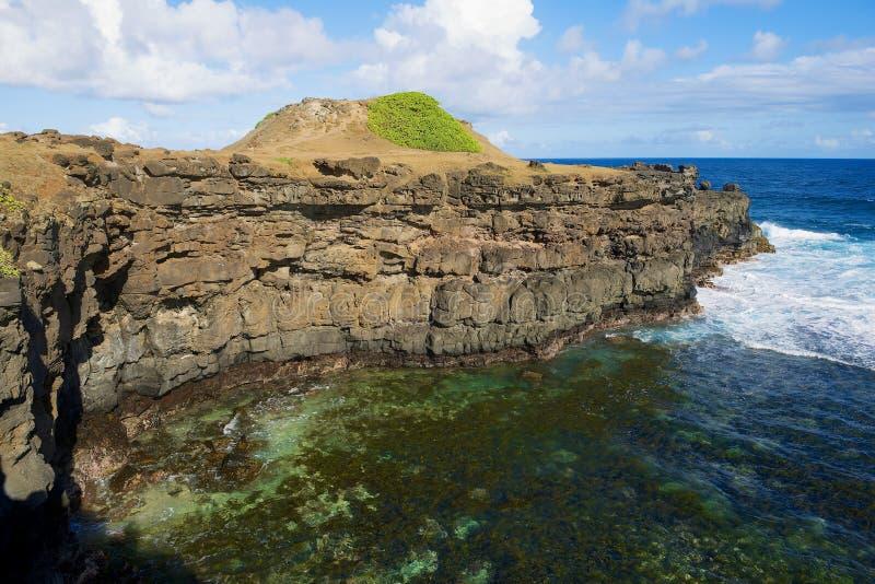 Härlig Gris-Grisudde med blå himmel och indiska havvågor på den Mauritius ön royaltyfria foton