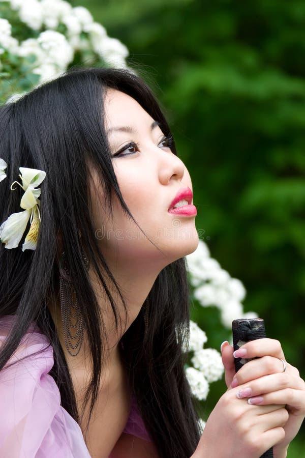 härlig japansk kvinna royaltyfri foto