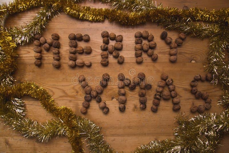 """Härlig julplats med """"Merry Xmas†för stor rubrik  royaltyfria bilder"""
