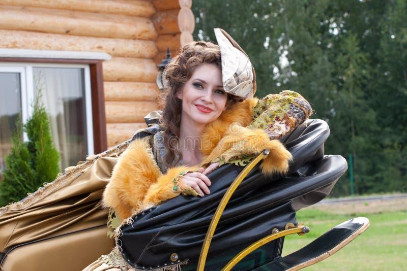 härlig klänningkvinna fotografering för bildbyråer