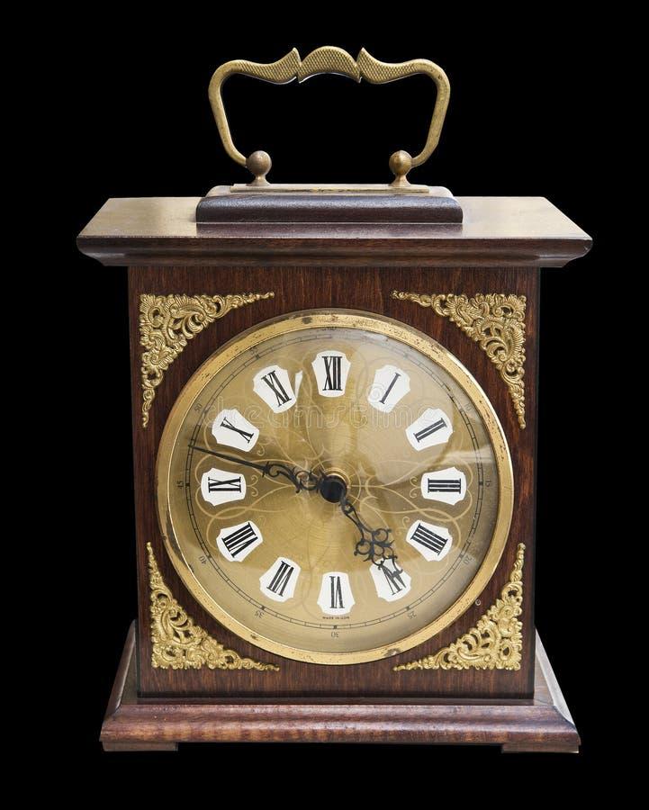 Härlig klocka för tappning med ett träfall och guld- smycken som isoleras på svart arkivfoton