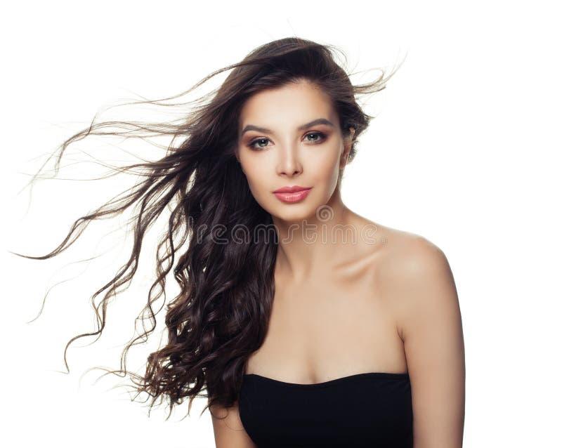 Härlig kvinna för modemodell med länge att blåsa hår som isoleras på vit bakgrund royaltyfria bilder