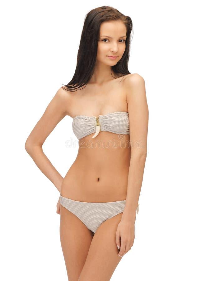 Härlig kvinna i bikini royaltyfri fotografi