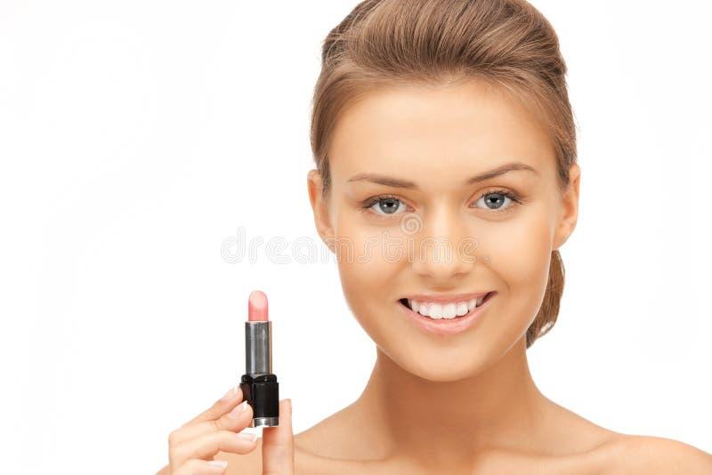 Härlig kvinna med läppstift royaltyfri fotografi