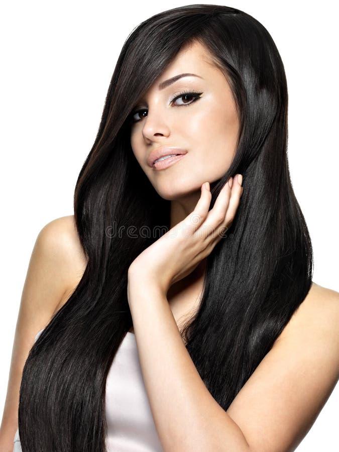 Härlig kvinna med långt rakt hår arkivbilder