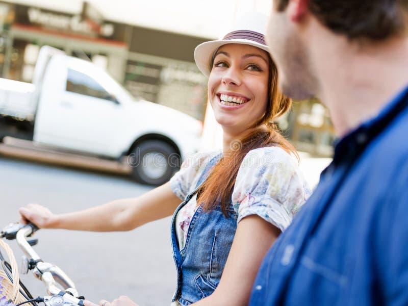 Härlig kvinnaridning på cykeln royaltyfria foton