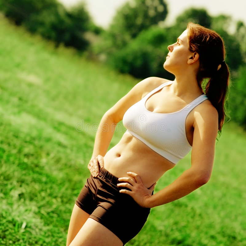 härlig löparekvinna royaltyfri foto