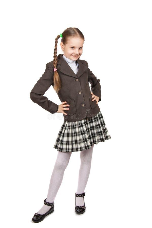 Härlig liten flicka i skolalikformig med böcker arkivfoto