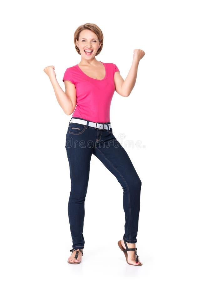Härlig lycklig kvinna som firar framgång som är en vinnare royaltyfri fotografi