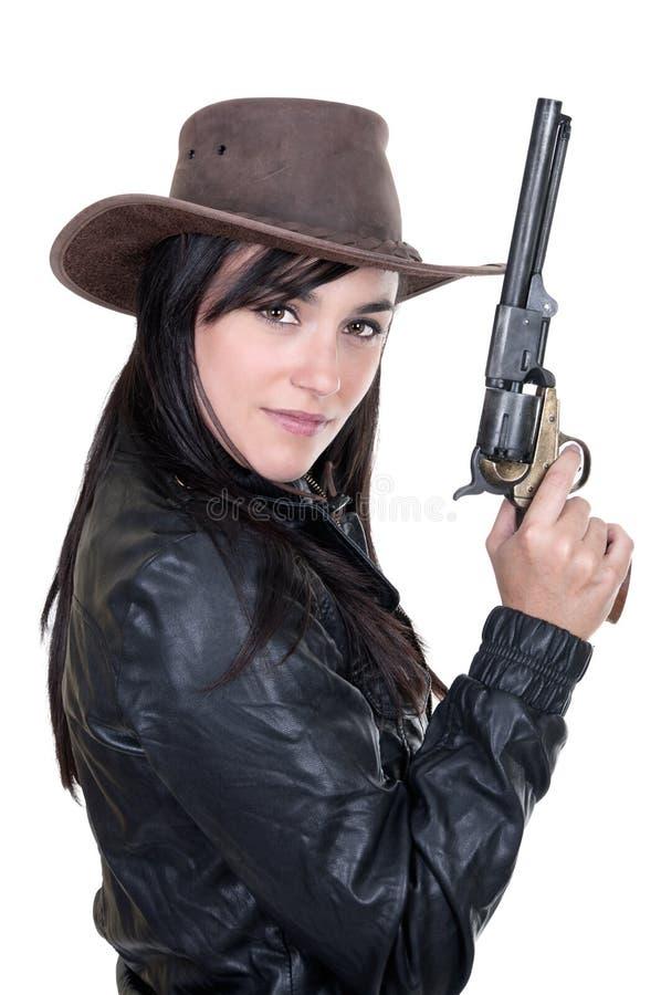 härlig modell för holding för brunettcowgirltryckspruta royaltyfri foto