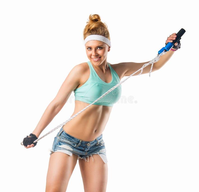 Härlig muskulös passformkvinna fotografering för bildbyråer