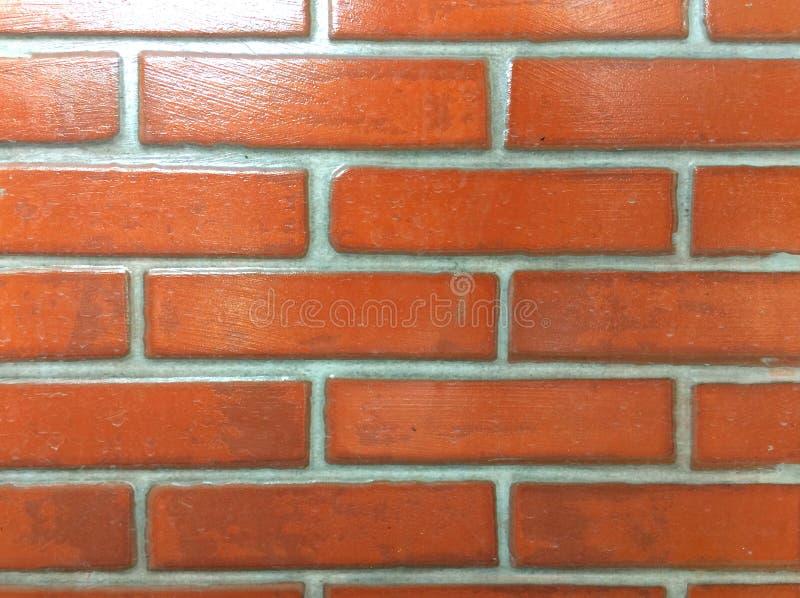 Härlig orange tegelstenbakgrund arkivfoto