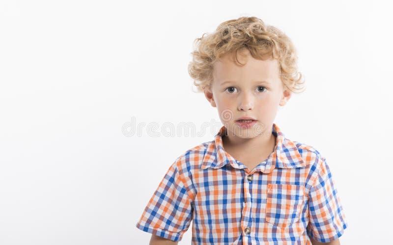 Härlig pojke med blond krullning royaltyfria bilder