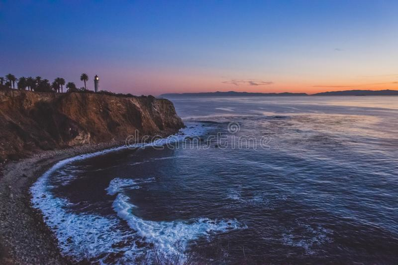 Härlig punkt Vicente Lighthouse på solnedgången fotografering för bildbyråer