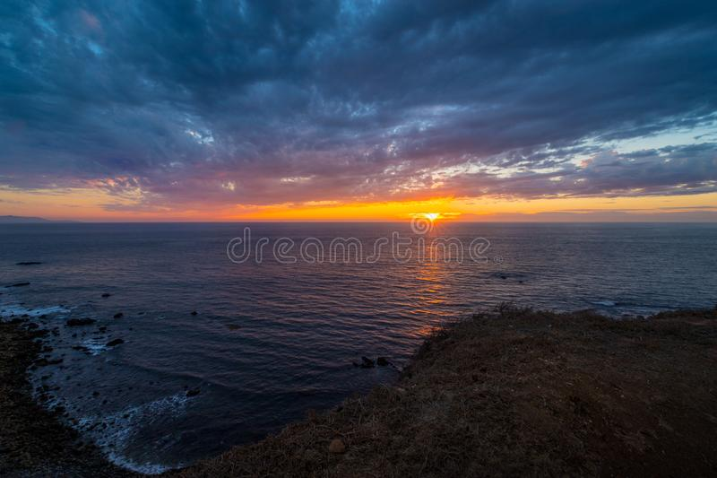 Härlig punkt Vicente Lighthouse på solnedgången arkivfoton