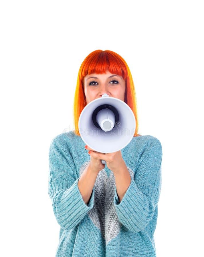 Härlig rödhårig mankvinna med en megafon royaltyfria foton