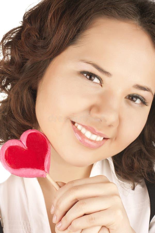 härlig red för flickahjärtaholding royaltyfri fotografi