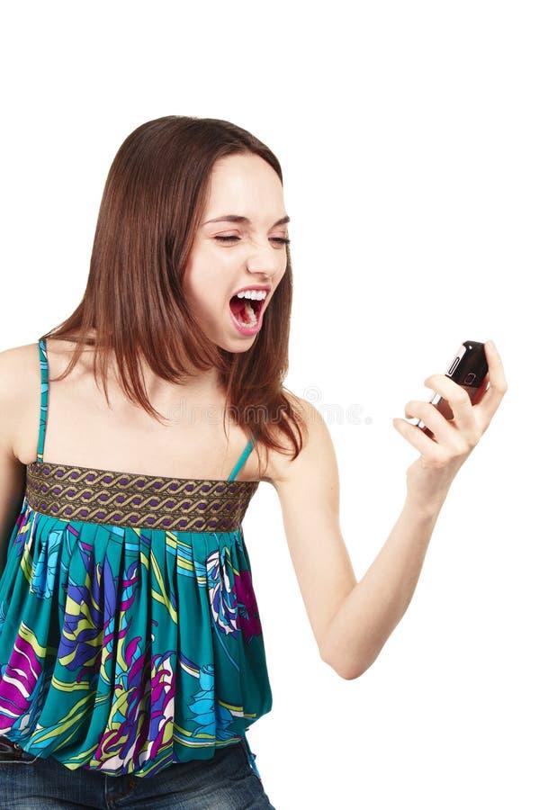 härlig seende mobil telefonkvinna royaltyfri bild