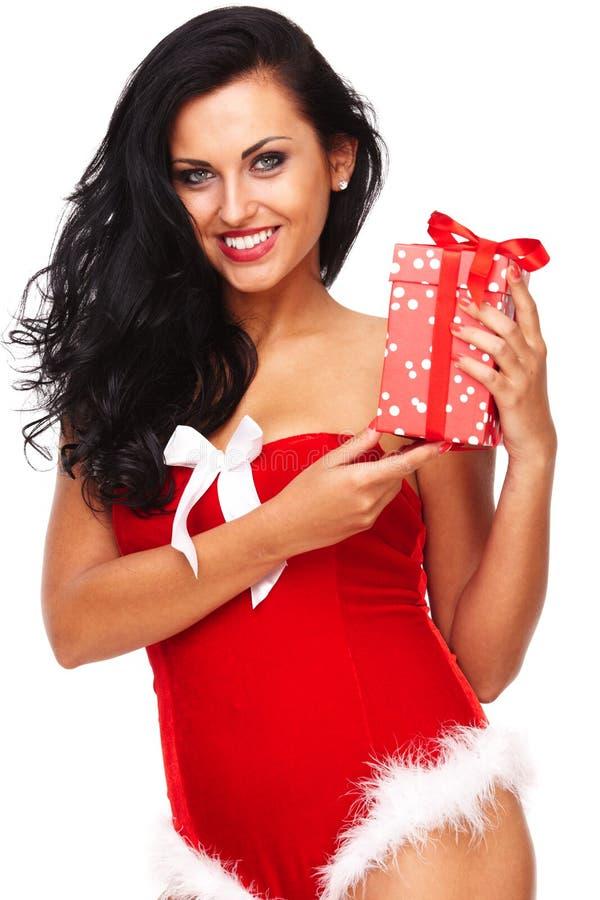 Härlig sexig flicka som bär Santa Claus kläder arkivbild