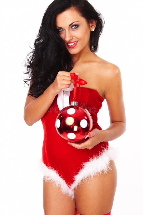 Härlig sexig flicka som bär Santa Claus kläder arkivfoto