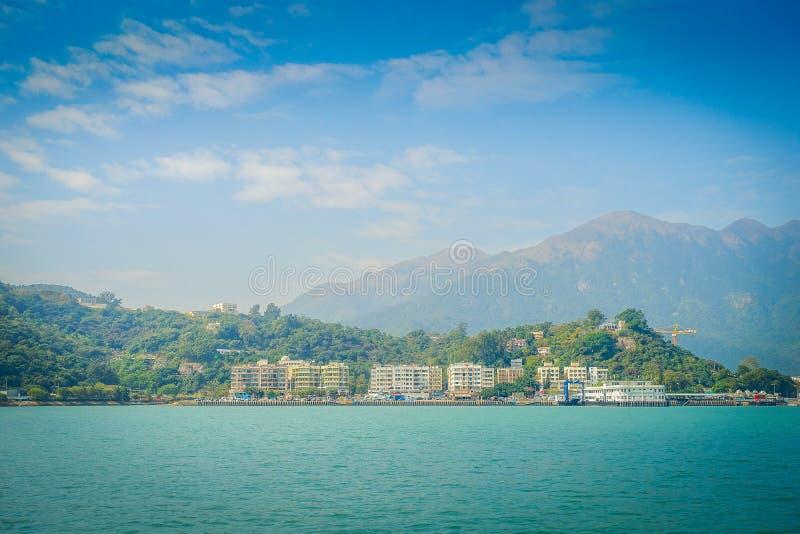 Härlig sikt av muiwo-staden i horisonten på den lantliga staden som lokaliseras i den Hong Kong lantauön royaltyfri bild