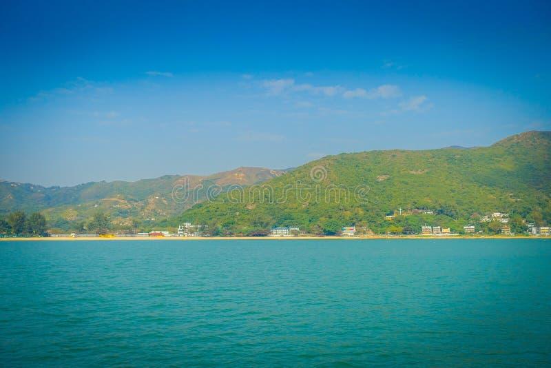 Härlig sikt av muiwo-staden i horisonten på den lantliga staden som lokaliseras i den Hong Kong lantauön arkivfoton