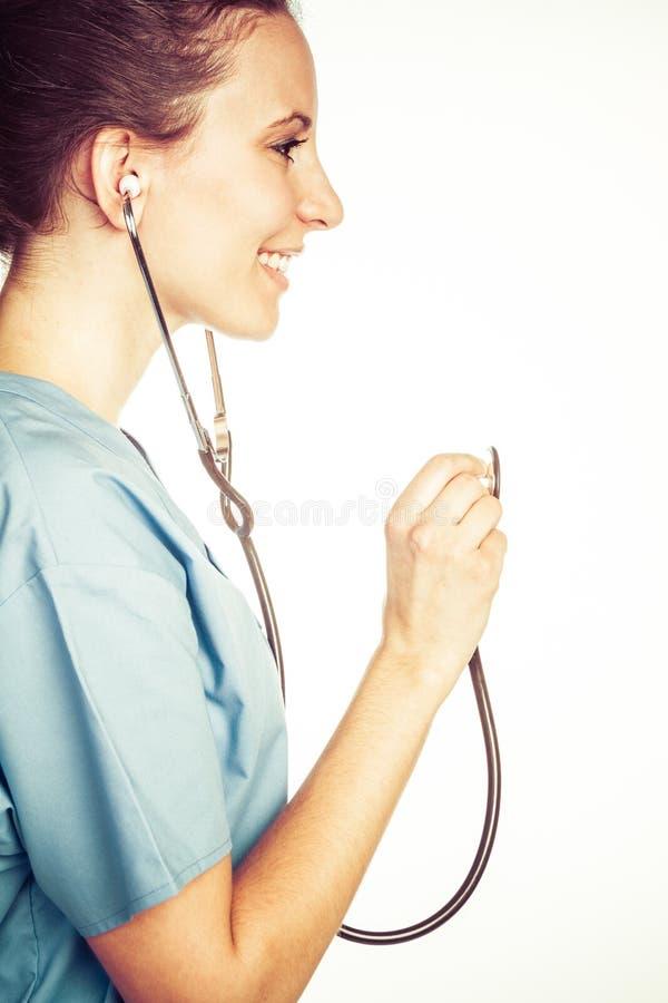 Härlig sjuksköterska med stetoskopet royaltyfria bilder