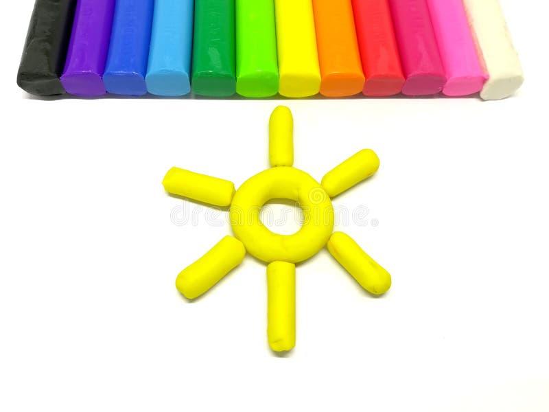 Härlig soldeg, färgrik plasticinelera klibbar arkivbilder