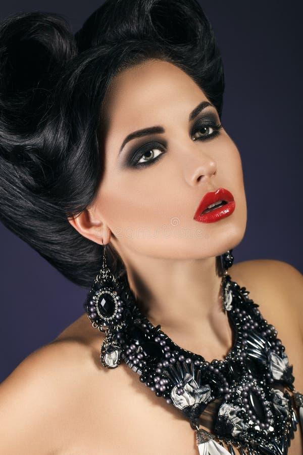 Härlig stående av en flicka, makeup royaltyfria bilder