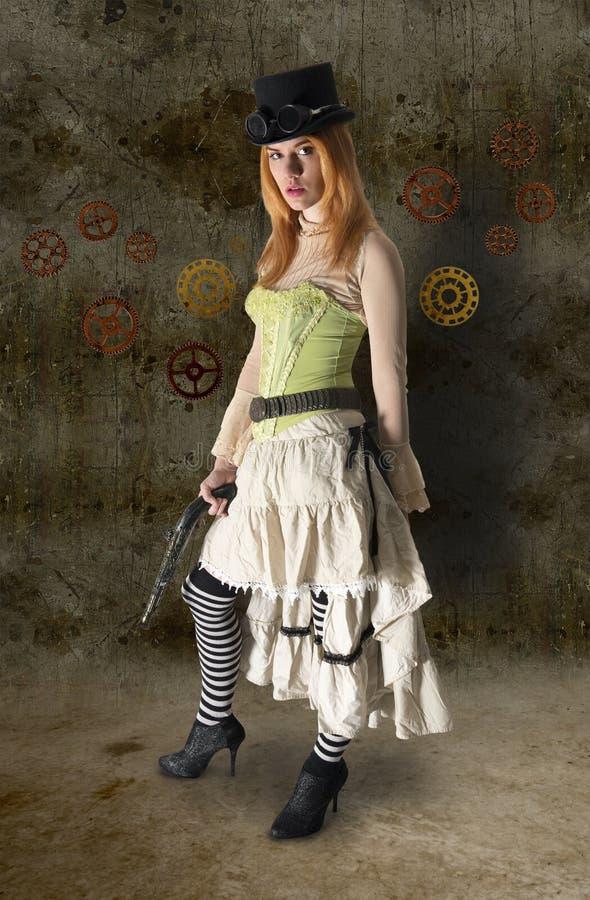 Härlig Steampunk kvinnastående med GrungeBac royaltyfri bild