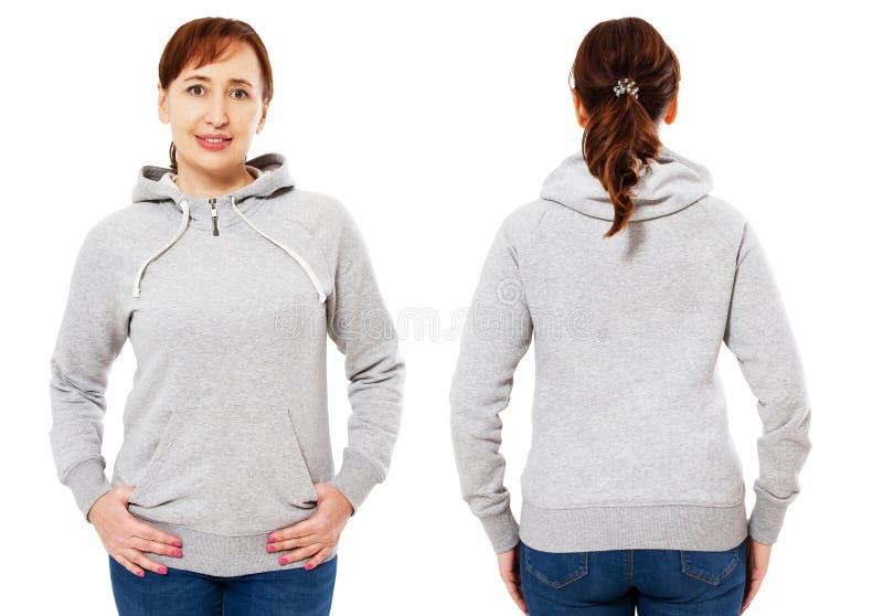Härlig stilfull mitt-ålder kvinna i hoodieframdelen och tillbaka sikten, vit kvinna i tröjamodellen som isoleras på vit bakgrund arkivfoton