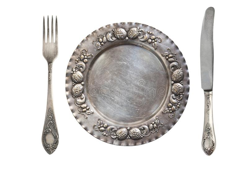 Härlig tappning försilvrar den Ajour skeden, kniven och plattan som isoleras på vit bakgrund antik silverware royaltyfria bilder