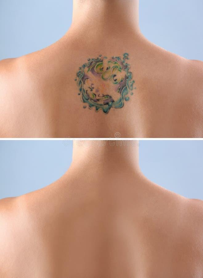 Härlig tatuering på kvinnligbaksida royaltyfria foton