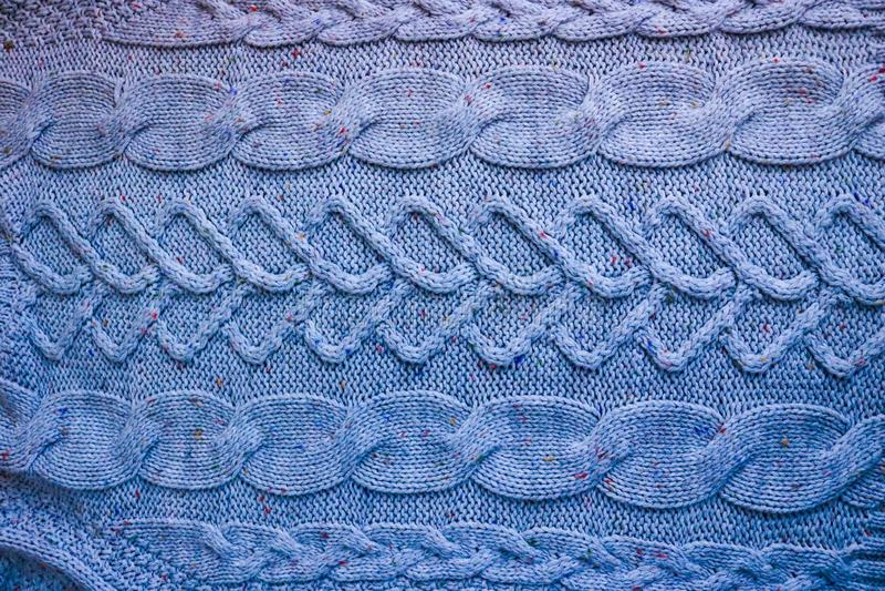 Härlig textur av en mjuk varm naturlig tröja med en stucken modell av trådar grönska för abstraktionbakgrundsgentile royaltyfria foton