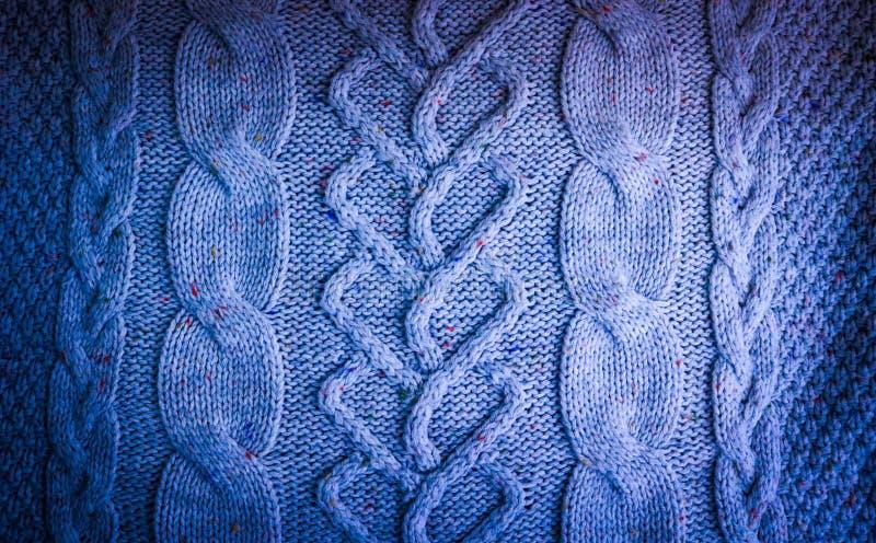 Härlig textur av en mjuk varm naturlig tröja med en stucken modell av trådar grönska för abstraktionbakgrundsgentile arkivbilder
