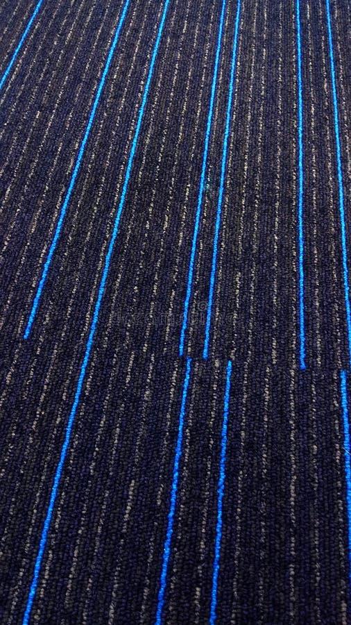 Härlig texturerad matta med blålinjen royaltyfria bilder