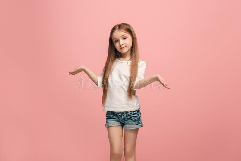 Härlig tonårig flicka som ser förvånad och förbryllad arkivbilder
