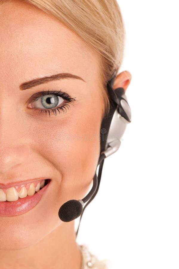 Härlig ung affärskvinna med hörlurar med mikrofon arkivfoton