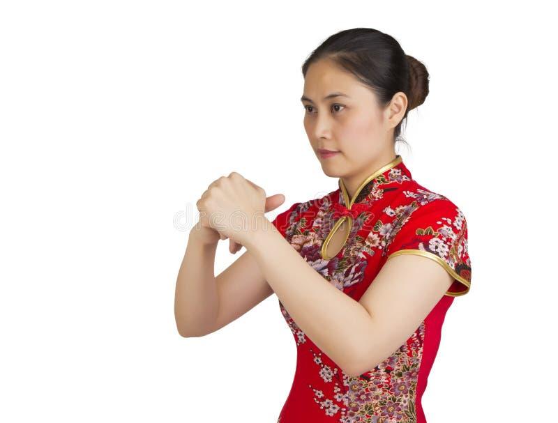 Härlig ung asiatisk kvinna med gest av lyckönskan, happ royaltyfria bilder
