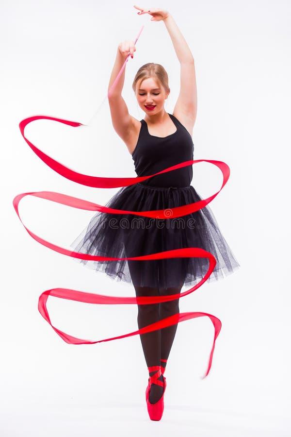 Härlig ung blond övning för calilisthenics för utbildning för kvinnabalettgymnast arkivbilder