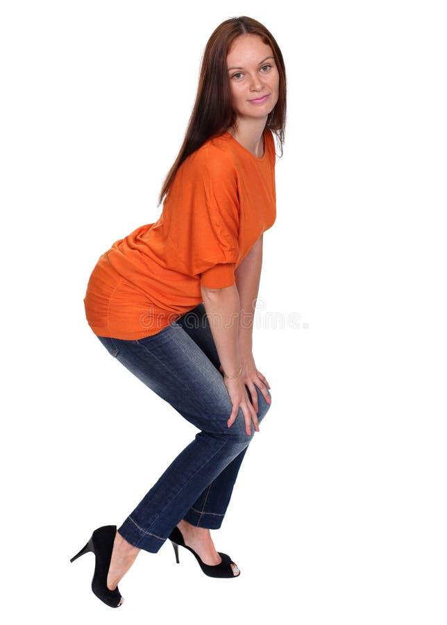 Download Härlig ung dam i jeans arkivfoto. Bild av orange, nätt - 37346256