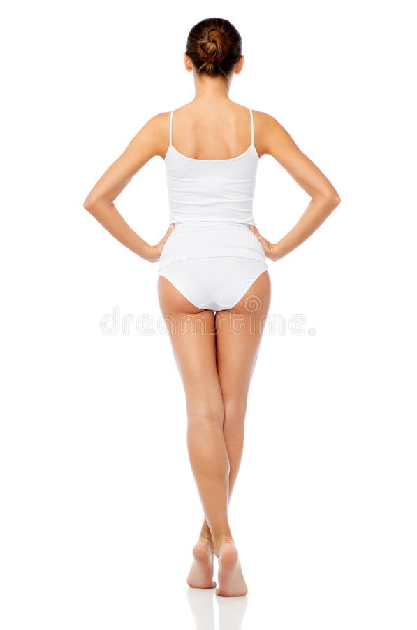 Härlig ung kvinna i den vita underkläderna royaltyfri foto