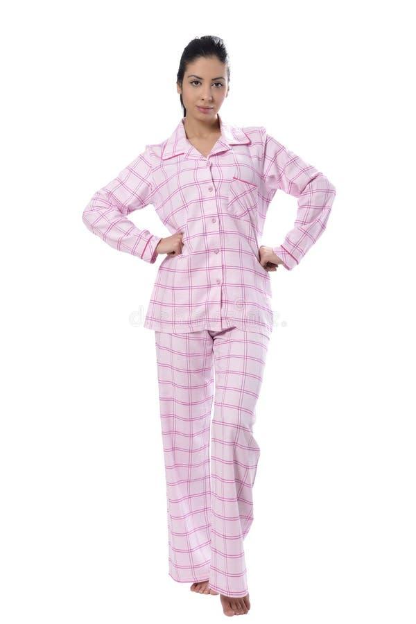 Härlig ung kvinna i pyjama royaltyfria bilder