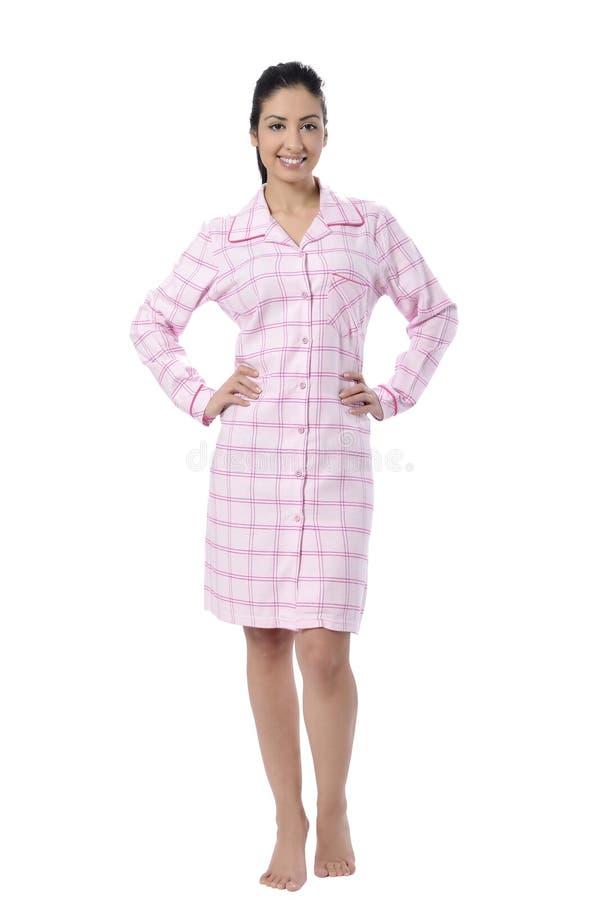 Härlig ung kvinna i pyjama fotografering för bildbyråer