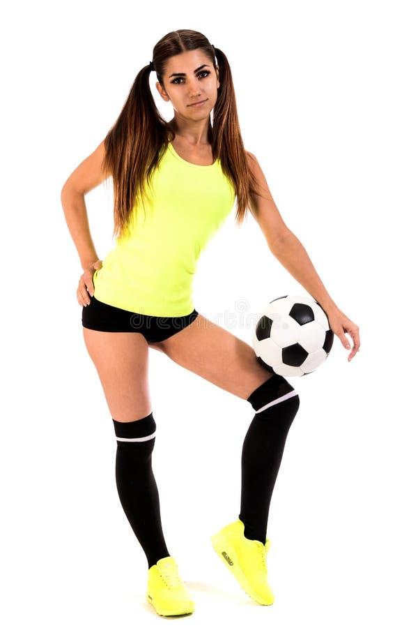Härlig ung kvinna med en fotboll royaltyfri foto