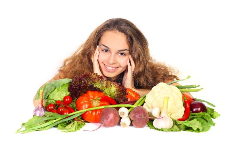 Kvinna med grönsaker arkivfoton