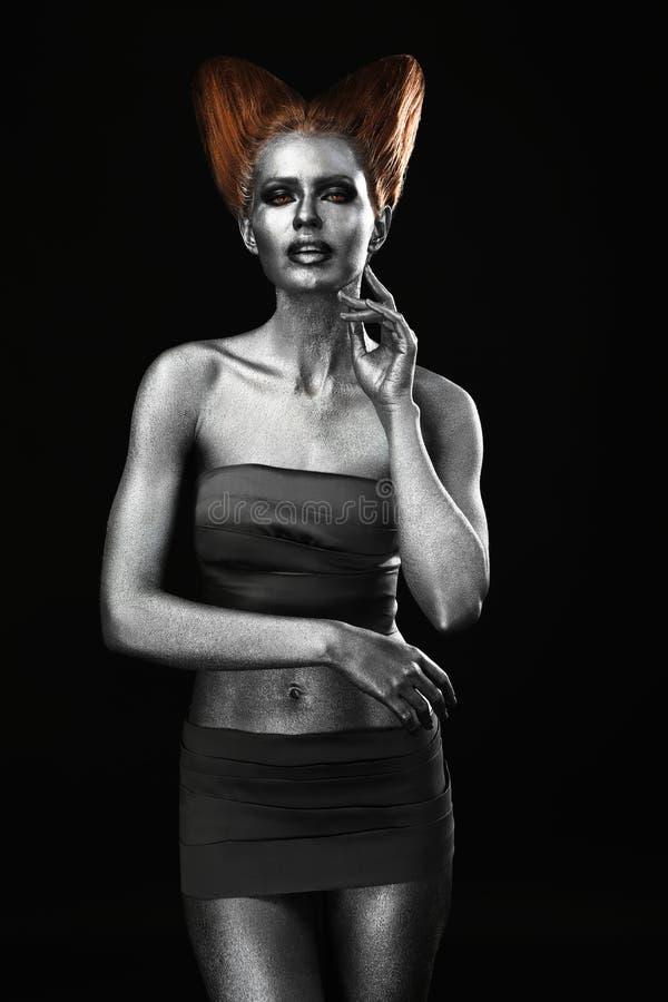 Härlig ung kvinna med fantastisk kropp-konst som capricorn royaltyfria bilder