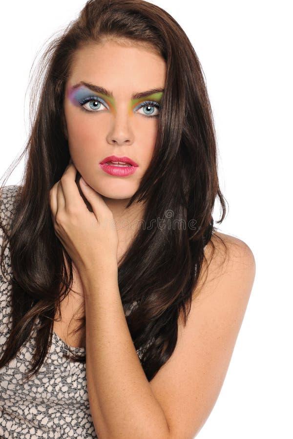 Härlig ung kvinna med konstnärligt smink royaltyfria foton